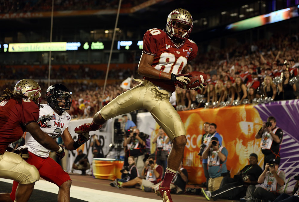 . Rashad Greene #80 of the Florida State Seminoles catches a 6-yard touchdown reception in the second quarter against the Northern Illinois Huskies during the Discover Orange Bowl at Sun Life Stadium on January 1, 2013 in Miami Gardens, Florida.  (Photo by Streeter Lecka/Getty Images)