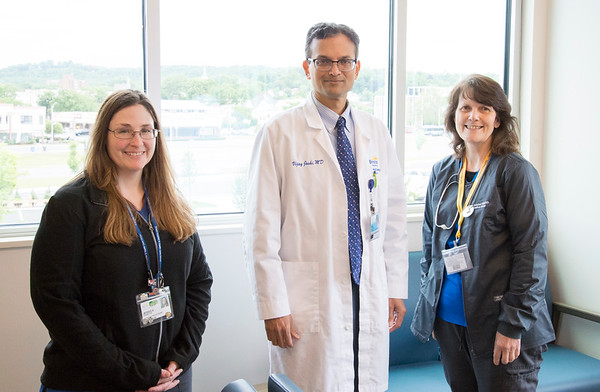 06/10/19 Wesley Bunnell | Staff Secretary/Receptionist Jessica Cossette, Dr. Vijay Joshi, MD and Medical Assistant Gail Fitzpatrick pose for a photo on the second floor of the Bristol Health Medical Care Center which opened for patients on Monday.