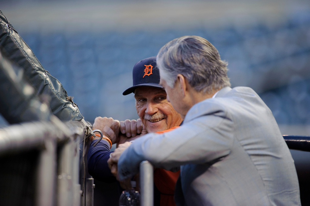 . MINNEAPOLIS, MN - SEPTEMBER 25: Manager Jim Leyland #10 and president, chief executive officer and general manager David Dombrowski of the Detroit Tigers speak during batting practice before the game against the Minnesota Twins on September 25, 2013 at Target Field in Minneapolis, Minnesota. (Photo by Hannah Foslien/Getty Images)