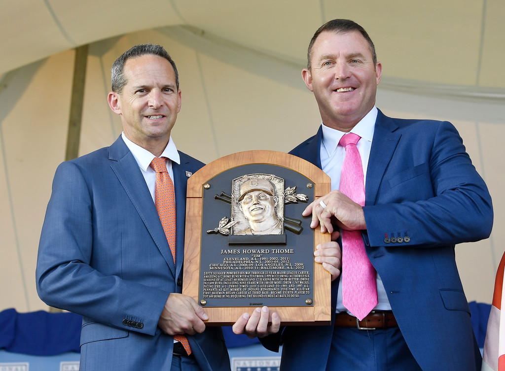 . Hall of Fame President Jeff Idelson, left, poses with Jim Thome, during an induction ceremony at the Clark Sports Center on Sunday, July 29, 2018, in Cooperstown, N.Y. (AP Photo/Hans Pennink)