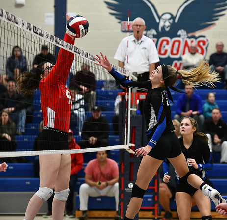 11/7/2019 Mike Orazzi | StaffrBristol Eastern's Ryley Plourde (11) and Conard High School's Avery Theriault (42) during the CCC girls volleyball tournament at Avon High School on Thursday.