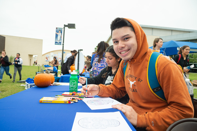 Luis Almendarez coloring in a decorated skull at the 2018 Fall Festival.