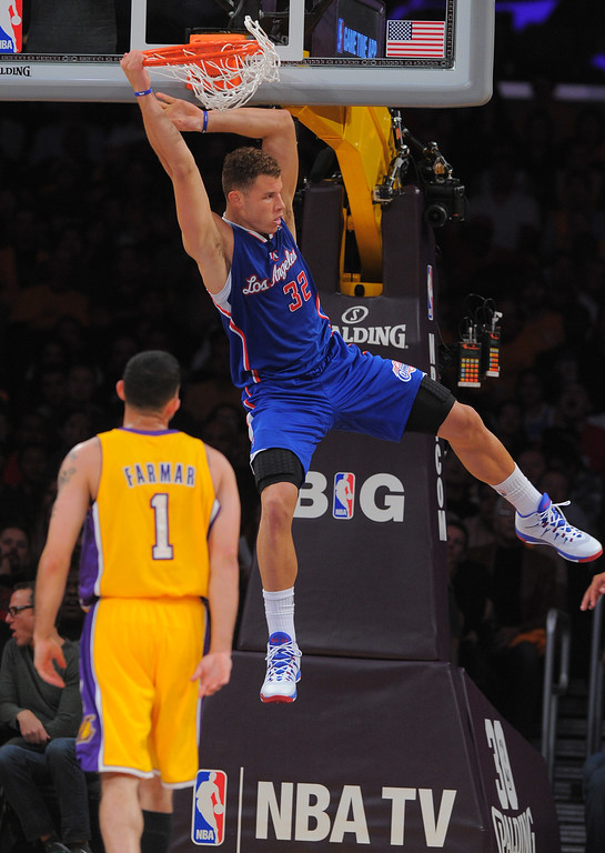 . Clippers Blake Griffin dunks in the 1st half in the NBA season opener between the Lakers and Clippers at Staples Center in Los Angeles, CA on Tuesday, October 29, 2013.   (Photo by Scott Varley, Daily Breeze)