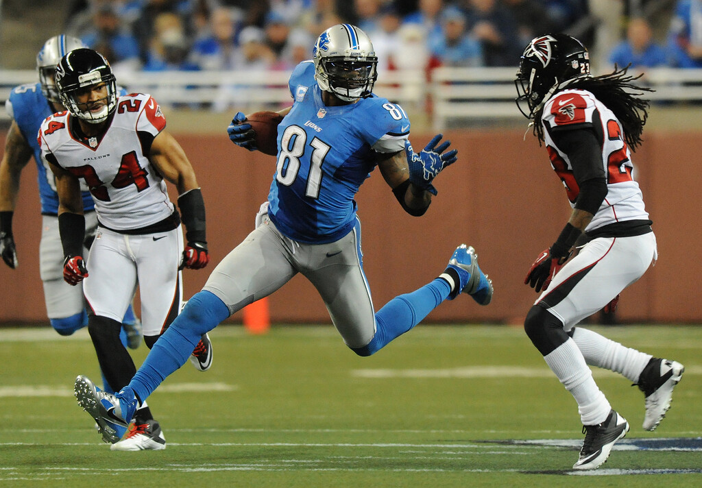 . Detroit Lions wide receiver Calvin Johnson (81) hauls in a pass for yardage in the third quarter against the Atlanta Falcons.  The Falcons beat the Lions, 31-18.  Photo taken on Saturday, December 22, 2012, at Ford Field in Detroit, Mich.  (Special to The Oakland Press/Jose Juarez)