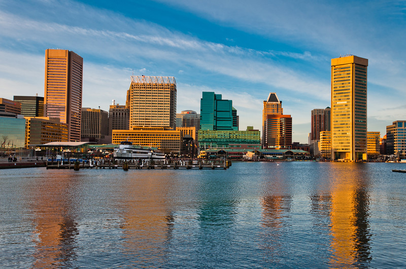 Evening light on the Inner Harbor and skyline in Baltimore, Maryland.