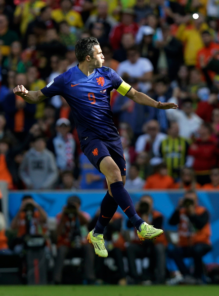 . Netherlands\' Robin van Persie celebrates after scoring his side\'s second goal during the group B World Cup soccer match between Australia and the Netherlands at the Estadio Beira-Rio in Porto Alegre, Brazil, Wednesday, June 18, 2014.  (AP Photo/Fernando Vergara)