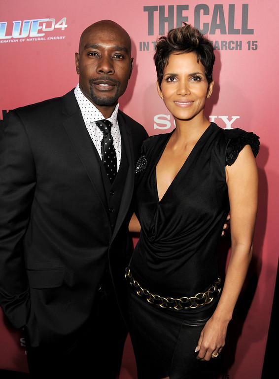 ". Actors Morris Chestnut (L) and Halle Berry arrive at the premiere of Tri Star Pictures\' ""The Call\"" at the Arclight Theatre on March 5, 2013 in Los Angeles, California.  (Photo by Kevin Winter/Getty Images)"