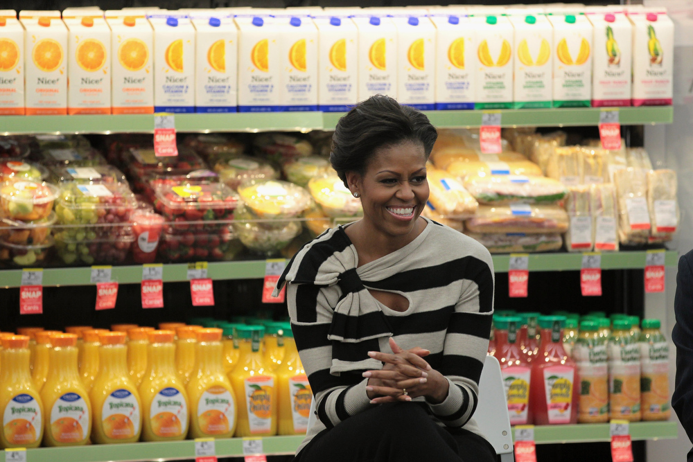 ". First lady Michelle Obama visits a Walgreens store that sells produce on October 25, 2011 in Chicago, Illinois. The visit was part of the first lady\'s ""Let\'s Move!\"" initiative, which is designed to promote healthy eating and lifestyles in low-income areas. While visiting the city the first lady also took a tour of an urban farm.  (Photo by Scott Olson/Getty Images)"
