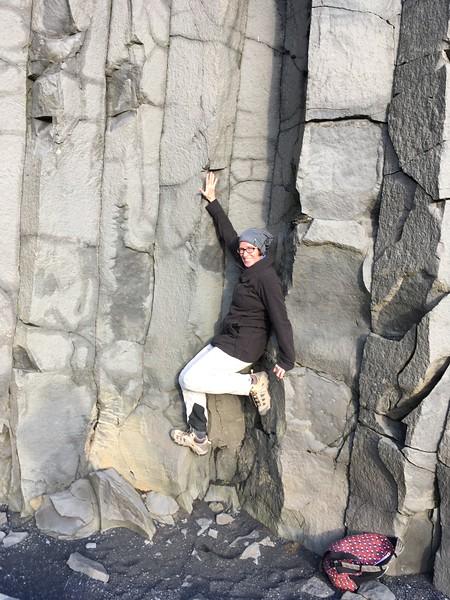 Arah ascends basalt columns at Reynisfjara black sand beach