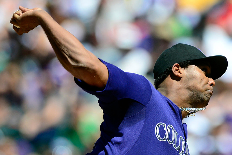 . Colorado Rockies starting pitcher Juan Nicasio (44) fires a pitch during the second inning in Denver. The Colorado Rockies hosted the San Diego Padres at Coors Field on Sunday, June 9, 2013. (Photo by AAron Ontiveroz/The Denver Post)