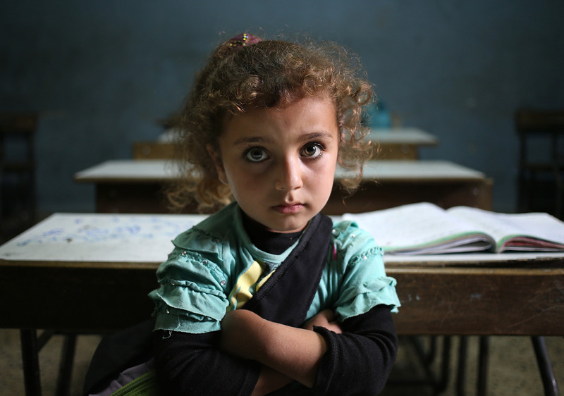 . In this picture taken on Thursday, May 29, 2014, a Syrian refugee girl sits in a classroom at a Lebanese public school where only Syrian students attend classes in the afternoon, at Kaitaa village in north Lebanon. (AP Photo/Hussein Malla)