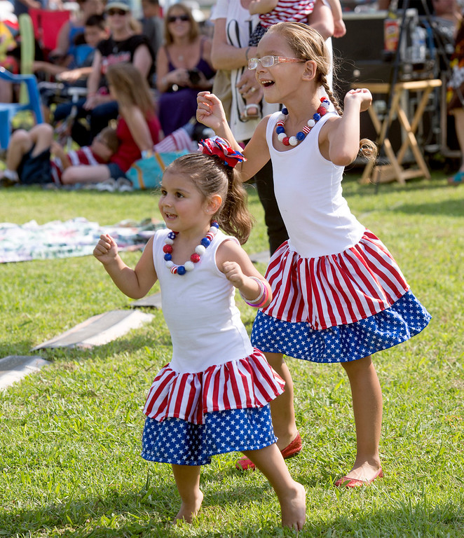 . Tristian Longacre , 3, left, and Trinity Schlotterbeck, 5, dance to the live band at La Mirada\'s annual Independence Day Celebration at La Mirada Regional Park July 3, 2013.   (SGVN/Staff photo by Leo Jarzomb)