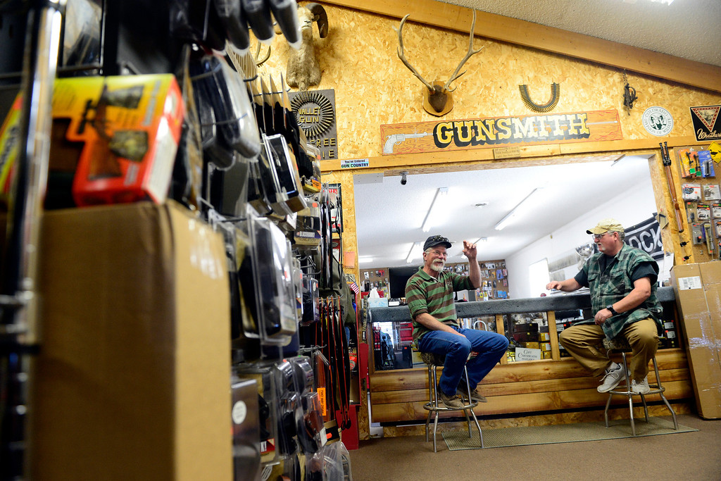 . MONTE VISTA, CO - FEBRUARY 26: Alan McFadden (left) and Jeff Willard joke inside of Valley Gun Services in Monte Vista. Store owner Carlton Thomas says that like the local famring co-op, the gun enthusiasts in the valley also have their own coffee clutch in which men gather to talk about everything -- not just guns. (Photo by AAron Ontiveroz/The Denver Post)