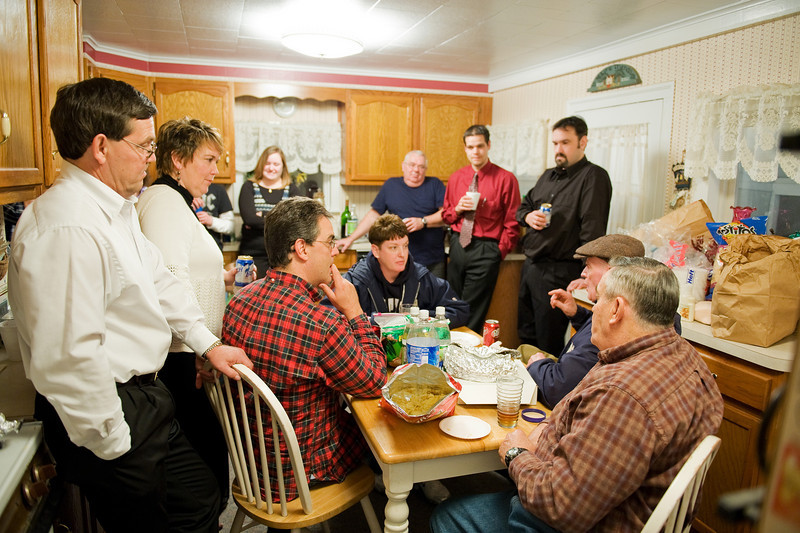 That is Jeff and Anne at left.  Johnny is seated.  Jeff's son is in the red shirt, and Brett is standing in black.
