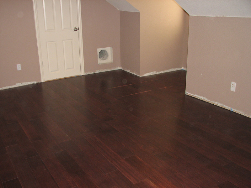 Flooring is complete, still have to replace baseboards and add quarter-round.