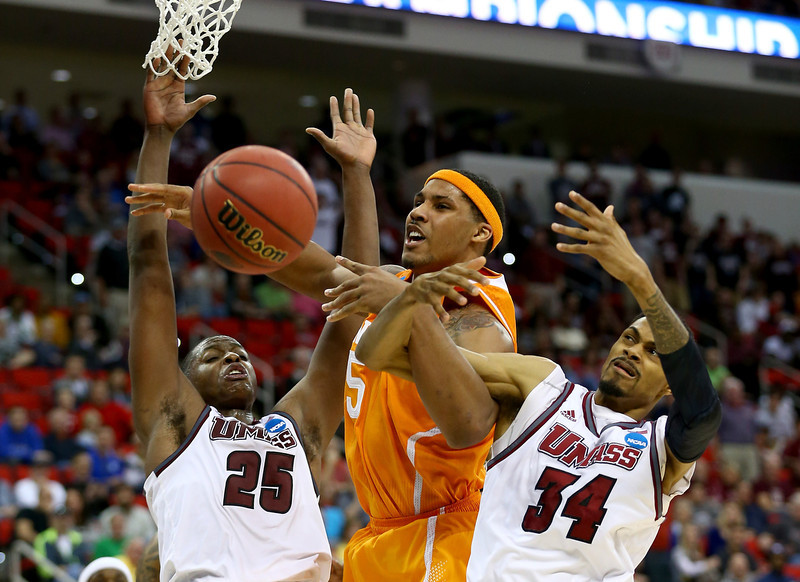 . Jarnell Stokes #5 of the Tennessee Volunteers goes up for the ball against Cady Lalanne #25 and Raphiael Putney #34 of the Massachusetts Minutemen in the second round of the 2014 NCAA Men\'s Basketball Tournament at PNC Arena on March 21, 2014 in Raleigh, North Carolina.  (Photo by Streeter Lecka/Getty Images)