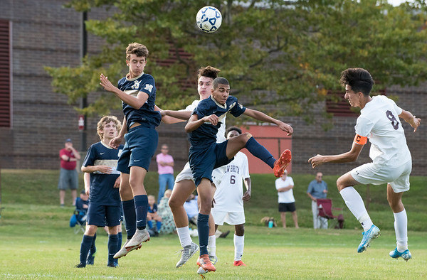 09/24/19 Wesley Bunnell | StaffrrNewington boys soccer defeated New Britain 3-1 on Tuesday afternoon at Newington High School. Newington's Stone Bouchard (13), New Britain's Patrick Pupklwski (13), Newington's Youseff Khadrani (17) and New Britain's John Morell (8) compete for the header.