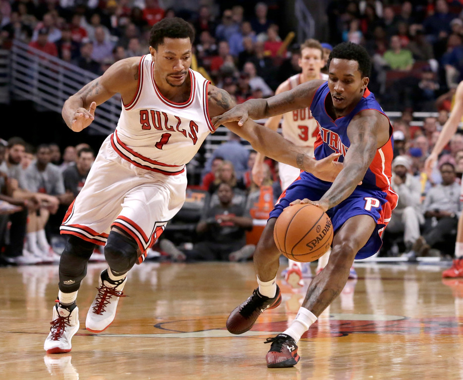 . Chicago Bulls guard Derrick Rose (1) battles Detroit Pistons guard Brandon Jennings (7) for a loose ball during the second half of an NBA basketball game Monday, Nov. 10, 2014, in Chicago. The Bulls won 102-91. (AP Photo/Charles Rex Arbogast)