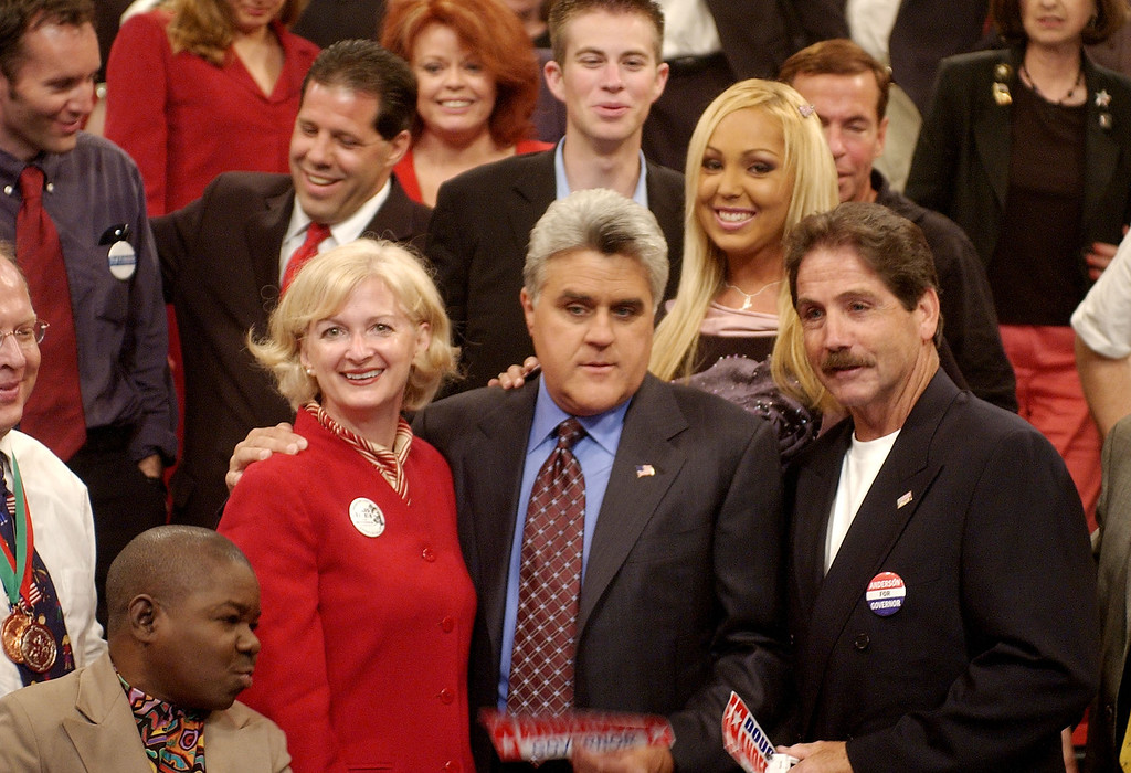 ". Jay Leno, center, poses with gubernatorial candidates actor Gary Coleman, left, Iris Adams, second left, and Douglas Anderson and the rest of 81 candidates after a taping of the Tonight Show Monday, Sept. 22, 2003, at NBC Studios in Burbank, Calif.  Standing in between Leno and Anderson is adult film actress Mary ""Mary Carey\"" Cook. The late-night host in August made an offer to the 135 candidates vying to replace Gov. Gray Davis to come on his show. (AP Photo/Kevork Djansezian)"
