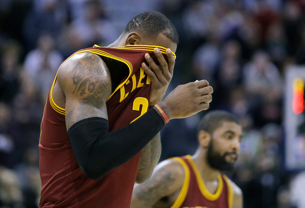. Cleveland Cavaliers forward LeBron James, left, wipes his face as he walks across the court during the second half of the team\'s NBA basketball game against the Utah Jazz on Tuesday, Jan. 10, 2017, in Salt Lake City. The Jazz won 100-92. (AP Photo/Rick Bowmer)