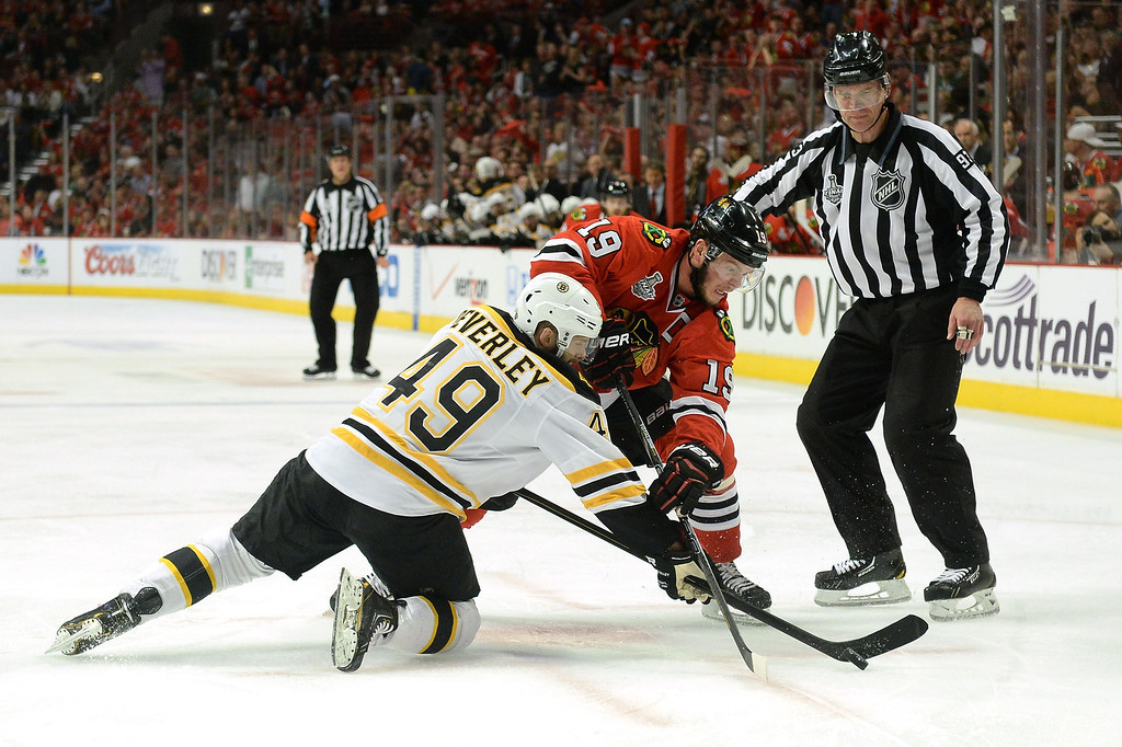 . CHICAGO, IL - JUNE 22:  Jonathan Toews #19 of the Chicago Blackhawks faces off against Rich Peverley #49 of the Boston Bruins in Game Five of the 2013 NHL Stanley Cup Final at United Center on June 22, 2013 in Chicago, Illinois.  (Photo by Harry How/Getty Images)