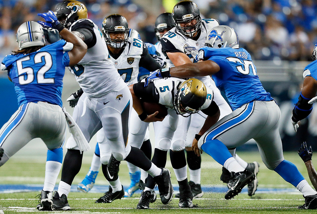 . Jacksonville Jaguars quarterback Blake Bortles (5) scrambles for yardage against the Detroit Lions in the second half of a preseason NFL football game at Ford Field in Detroit, Friday, Aug. 22, 2014. (AP Photo/Rick Osentoski)