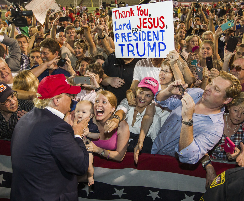 . Republican presidential candidate Donald Trump greets supporters after his rally at Ladd-Peebles Stadium on August 21, 2015 in Mobile, Alabama. The Trump campaign moved tonight\'s rally to a larger stadium to accommodate demand. (Photo by Mark Wallheiser/Getty Images)