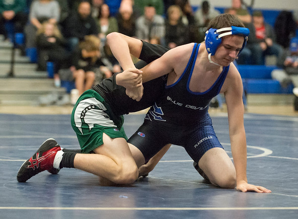 01/02/19 Wesley Bunnell | StaffrrPlainville wrestling was narrowly defeated at home by Maloney on Thursday night. Plainville's Ethan Miron vs Gavyn Marshall in the 126lb match.