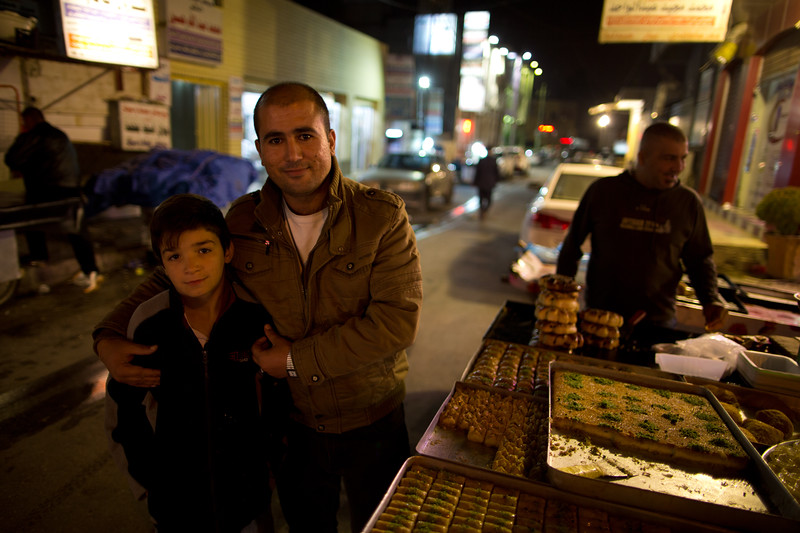 Father and son at a street side sweet stall in Erbil, Iraqi Kurdistan.