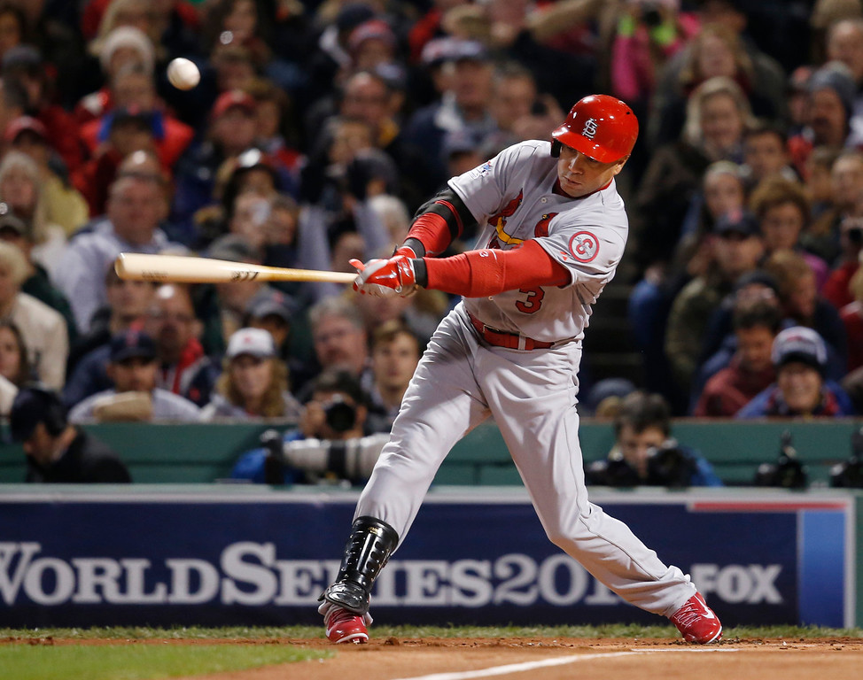 . St. Louis Cardinals\' Carlos Beltran hits a single off Boston Red Sox starting pitcher John Lackey during the first inning of Game 2 of baseball\'s World Series Thursday, Oct. 24, 2013, in Boston. (AP Photo/Elise Amendola)