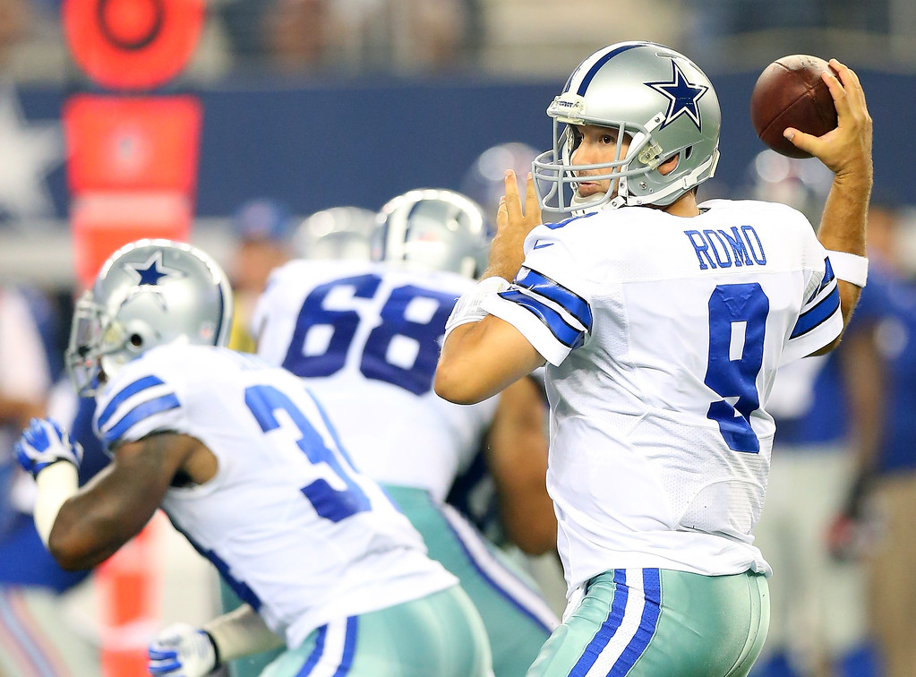 . Quarterback Tony Romo #9 of the Dallas Cowboys throws the ball in the second quarter against the New York Giants on September 8, 2013 at AT&T Stadium in Arlington, Texas.  (Photo by Ronald Martinez/Getty Images)
