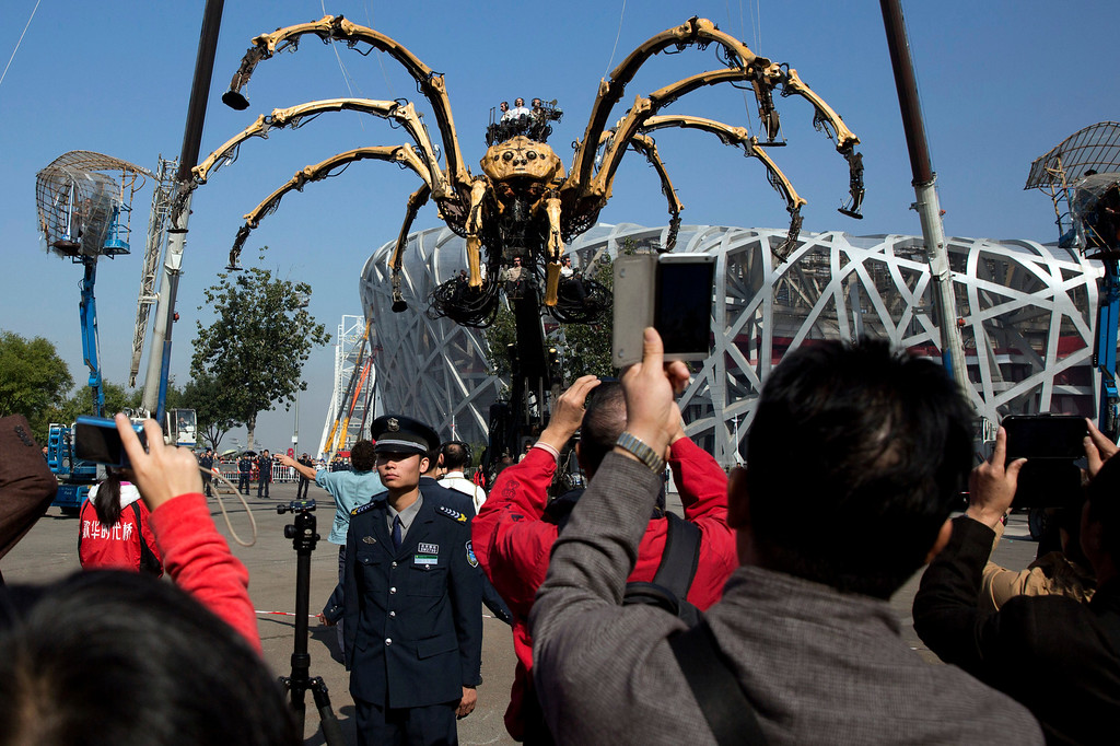". French production company La Machine\'s mechanical spider also known as ""La Princesse\"" take part in a show held in front of the Bird\'s Nest Stadium in Beijing, China, Friday, Oct. 17, 2014. A series of performances over three days will mark the climax of celebrations for the 50th anniversary of Sino-French diplomatic relations on Sunday, Oct 19.  (AP Photo/Ng Han Guan)"