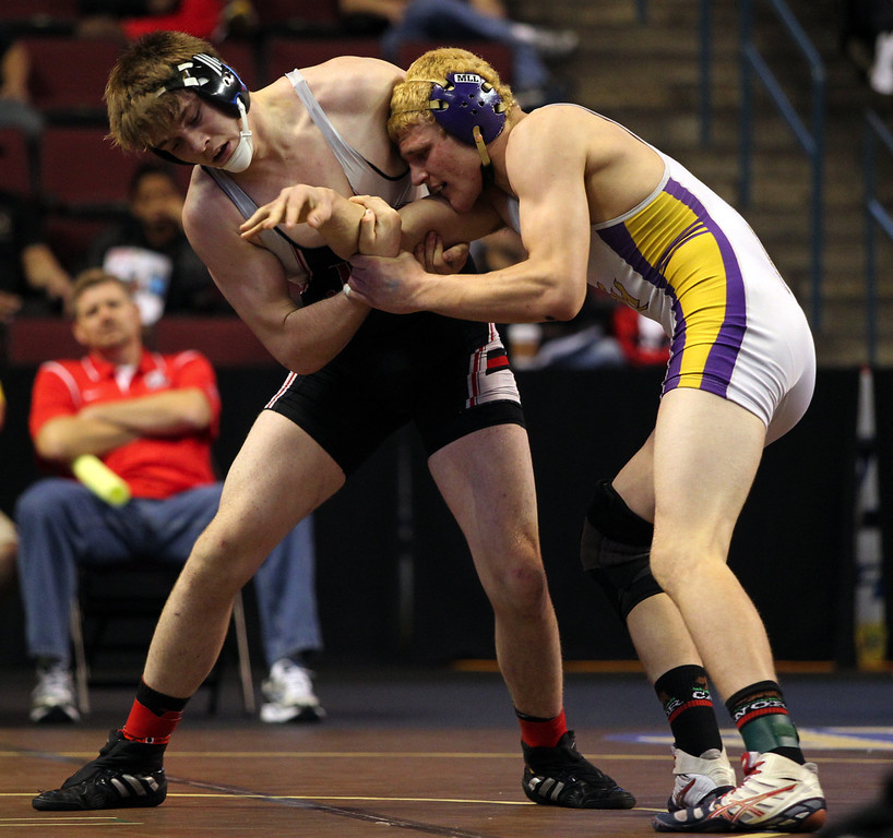 . James Logan\'s Clayton Hartwell, left, wrestles Bret Harte\'s Luke Brewer in a 195-pound consolation round match during the California Interscholastic Federation wrestling championships in Bakersfield, Calif., on Saturday, March 2, 2013. Hartwell would go onto win the match. (Anda Chu/Staff)