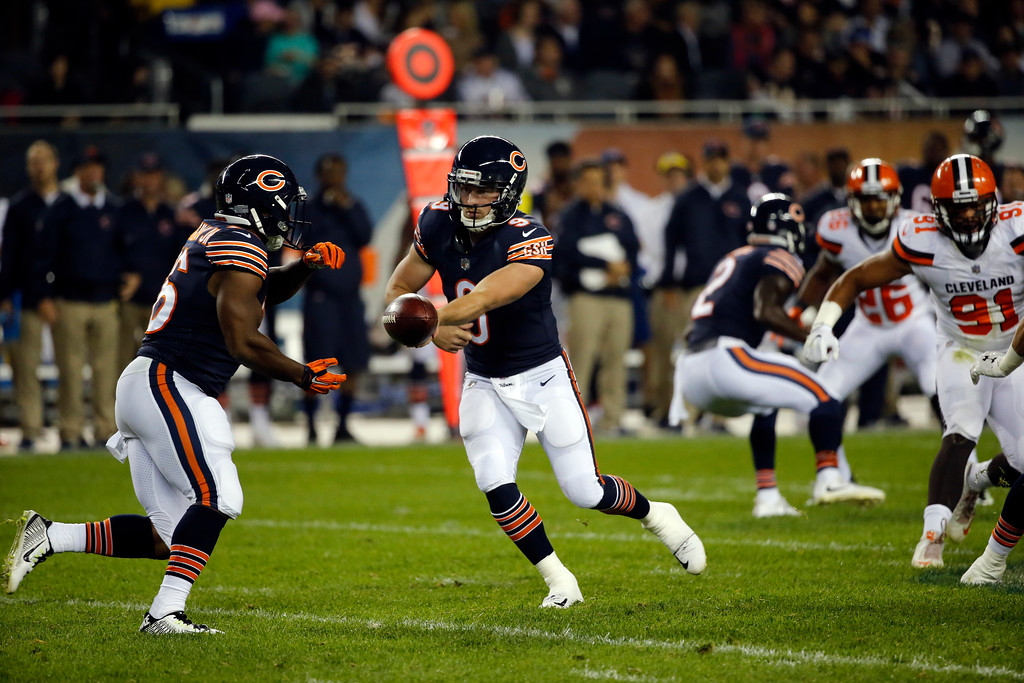 . Chicago Bears quarterback Connor Shaw (9) hands off the ball to running back Benny Cunningham (26) during the first half of an NFL preseason football game against the Cleveland Browns, Thursday, Aug. 31, 2017, in Chicago. (AP Photo/Charles Rex Arbogast)