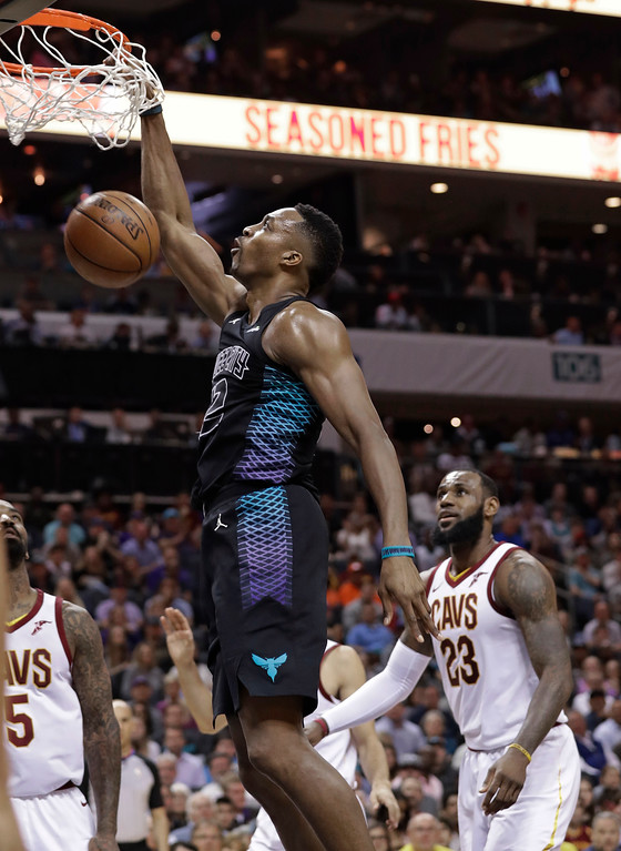 . Charlotte Hornets\' Dwight Howard dunks in front of Cleveland Cavaliers\' LeBron James, right, during the first half of an NBA basketball game in Charlotte, N.C., Wednesday, March 28, 2018. (AP Photo/Chuck Burton)