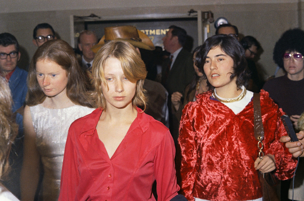 ". Members of Charles Manson\'s ""family\"" are shown outside the courtroom in the Los Angeles Hall of Justice after the hearing, Jan. 27, 1970.  Identifiable is Catherine \""Gypsy\"" Share, right. (AP Photo/David F. Smith)"