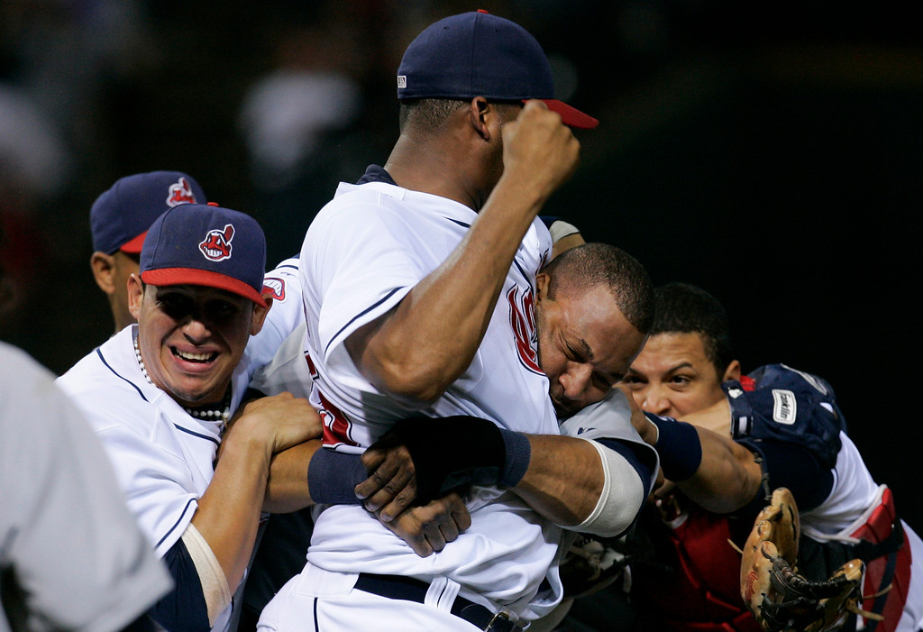 . Cleveland Indians pitcher Fausto Carmona,center, punches Detroit Tigers\' Gary Sheffield during a benches clearing brawl in the seventh inning in a baseball game, Friday, Sept. 19, 2008, in Cleveland. The Indians\' Asdrubal Cabrera, left, and Victor Martinez, right, stay close. (AP Photo/Tony Dejak)