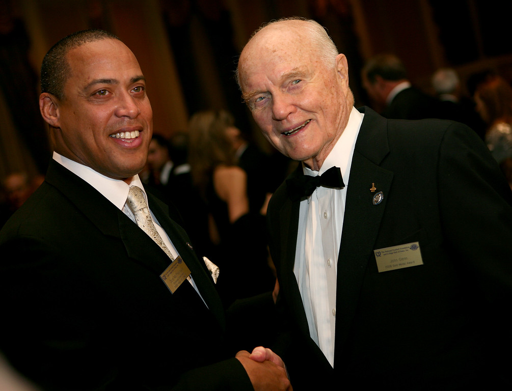 . National Football Foundation  Hall of Fame Class of 2008 honoree Don McPherson, left, who played at Syracuse, shakes hands with NFF Gold Medal recipient former US Senator John Glenn at the NFF and College Hall of Fame annual awards dinner at the Waldorf-Astoria in New York Tuesday, December 9, 2008. (AP Photo/Craig Ruttle)