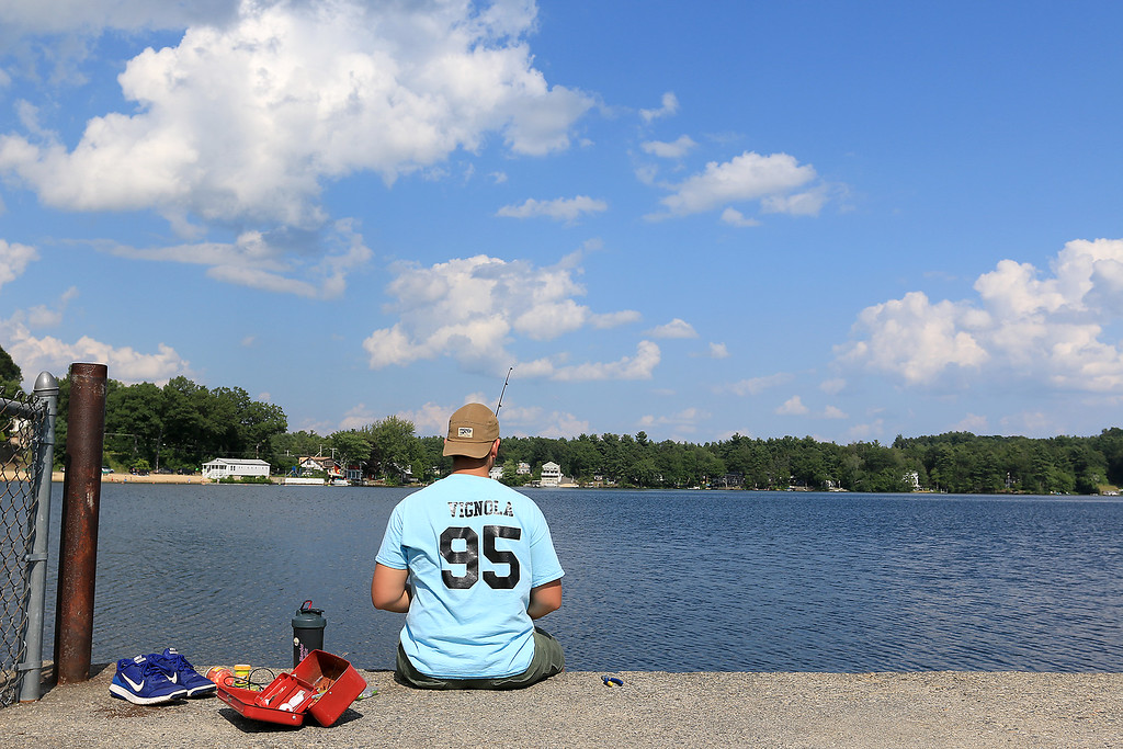 . Vincent Vignola, 16, of Leominster was out at Lake Whalom Tuesday afternoon trying to catch some fish. SENTINEL & ENTERPRISE/JOHN LOVE