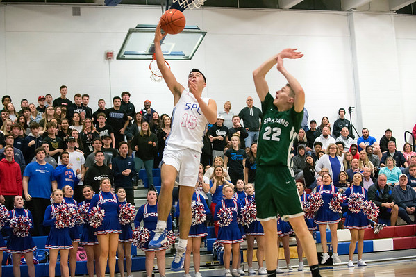 03/09/20 Wesley Bunnell | StaffrrSt. Paul boys basketball vs Maloney at St. Paul Catholic High School on Monday March 9, 2020. Jack Noli (15) with a late game lay up attempt.