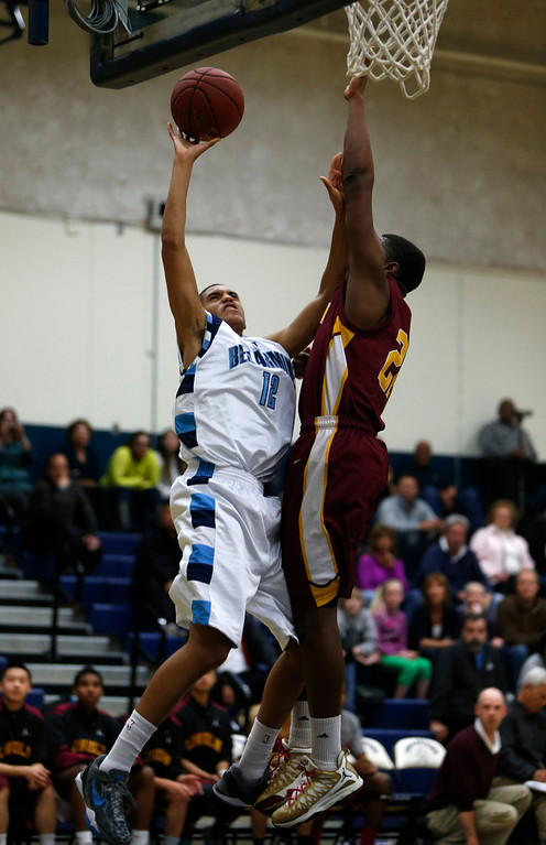 . Bellarmine College Preparatory\'s Blair Mendy (12) takes a shot against Lincoln High School\'s Davion Telfor (22) for their NorCal Division I Round 1 game in the first period at Bellarmine College Preparatory in San Jose, Calif., on Wednesday, March 6, 2013.  (Nhat V. Meyer/Staff)