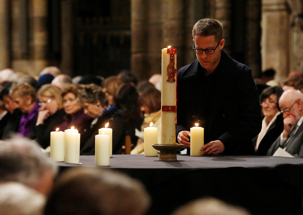 ". Chris Evans places a memorial candle for the victims of the Lockerbie bombing during a service of remembrance to mark the 25th anniversary of the attack at Westminster Abbey in London on December 21, 2013. Britain, the United States and Libya issued a joint call Saturday for justice over the Lockerbie bombing as services were held to mark the 25th anniversary of the attack, which claimed 270 lives. The three governments gave their ""deepest condolences\"" to relatives of those who died when Pan Am Flight 103 blew up over the Scottish town of Lockerbie on December 21, 1988, en route from London to New York.  AFP PHOTO / POOL / LUKE  MACGREGOR/AFP/Getty Images"