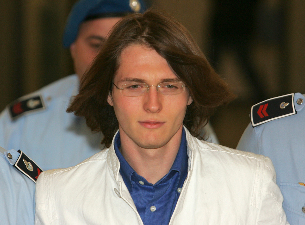 . Murder suspect Raffaele Sollecito  is escorted by Italian penitentiary police officers as he leaves Perugia\'s court after a hearing, central Italy, Friday Sept. 26, 2008.  (AP Photo/Pier Paolo Cito)