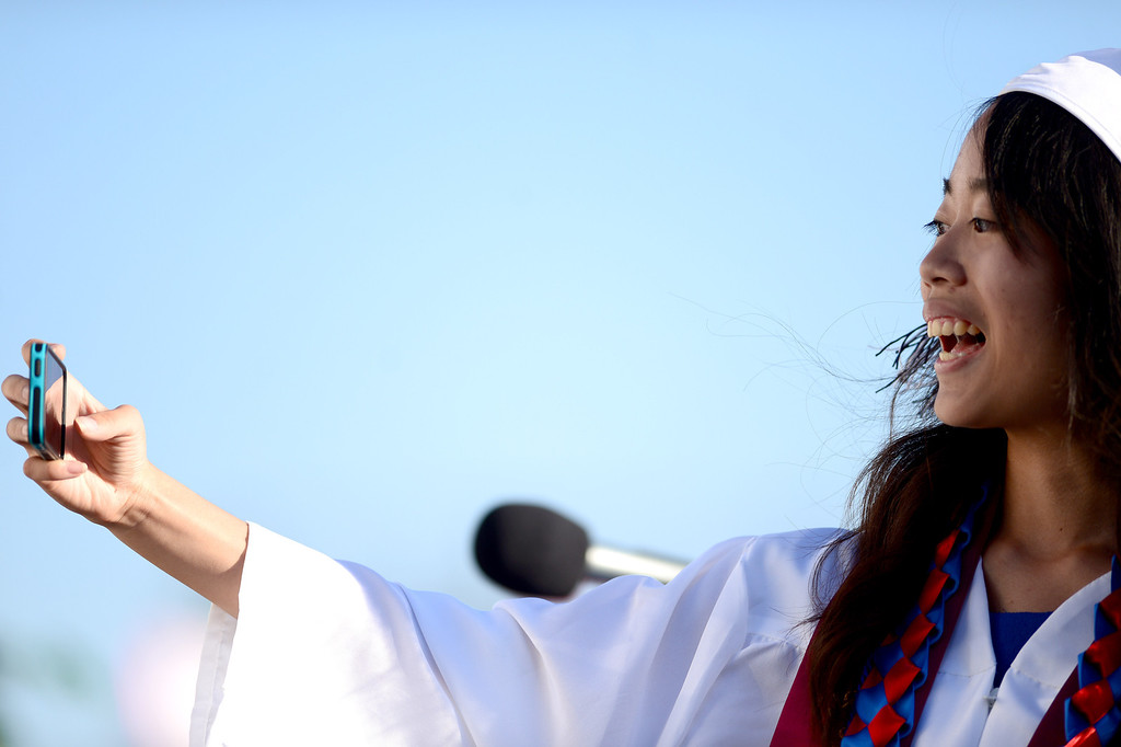 . Yun-Ju Chen takes a selfie before giving the valedictory address during Duarte High School\'s commencement ceremony Thursday night,  June 12, 2014 at the Duarte school. (Photo by Sarah Reingewirtz/Pasadena Star-News)