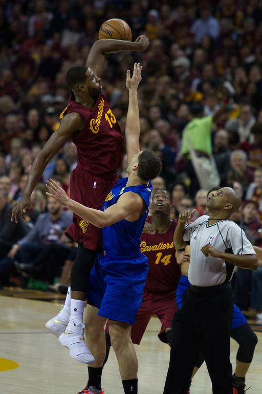 . The Cleveland Cavaliers\' Tristan Thompson (13) goes up for the jump ball against Klay Thompson (11) of the Golden State Warriors during an NBA game at the Quicken Loans Arena on Christmas day.  The Cavs defeated the Warriors 109-108.  Michael Johnson - The News Herald