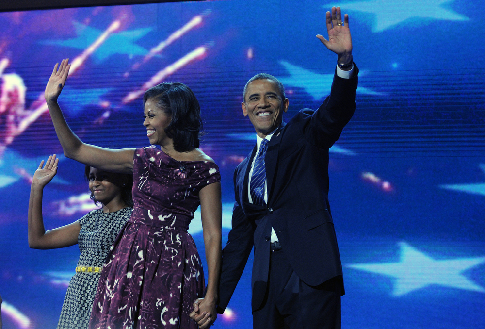 Description of . President Barack Obama accepted his party's nomination to be the 2012 Democratic Presidential candidate tonight September 6th, 2012.  His wife Michelle and daughters Malia and Sasha at the Democratic National Convention in Charlotte, North Carolina. Helen H. Richardson, The Denver Post