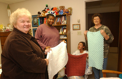 21889 Ladies Donating Blankets to Children's Hospital