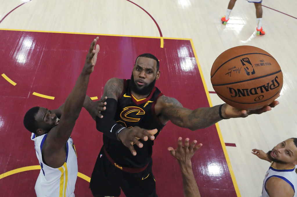 . Cleveland Cavaliers\' LeBron James shoots against Golden State Warriors\' Draymond Green during the first half of Game 3 of basketball\'s NBA Finals, Wednesday, June 6, 2018, in Cleveland. (Gregory Shamus/Pool Photo via AP)