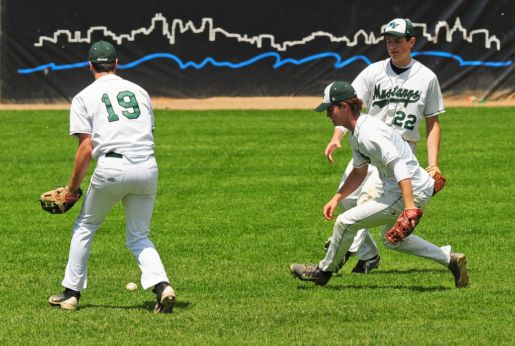 . Mounds View fielders (from left) Justin Ortt,  Mitch Fredrickson and Tucker Gran let a Forest Lake pop fly drop between them in the sixth inning.  (Pioneer Press: Scott Takushi)