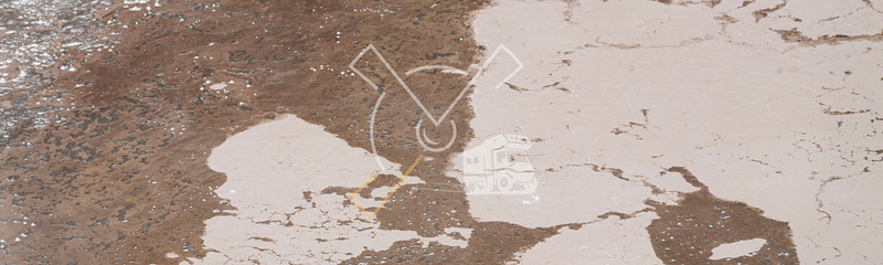 Abstract pattern of brown mud and acid at the geothermal area of Waiotapu in Rotorua